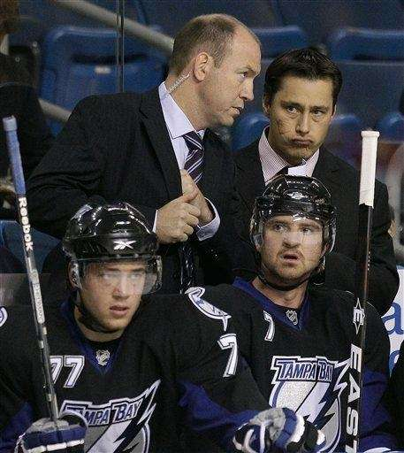 Tampa Bay Lightning coach Guy Boucher, right, talks