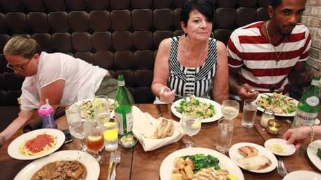 Diners enjoy their dishes at Tre Sorelle in