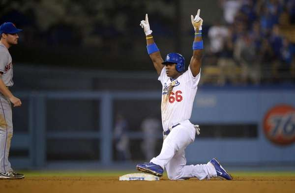 Dodgers' Yasiel Puig celebrates after hitting a double