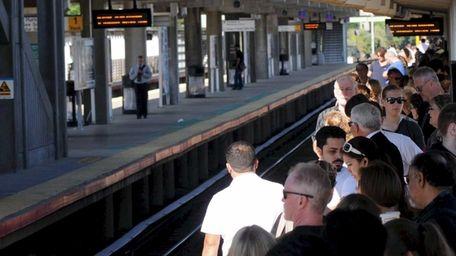 Commuters crowd platform at the Ronkonkoma station Thursday