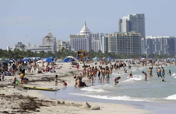 Beachgoers enjoy a day on Miami Beach, Fla.'s