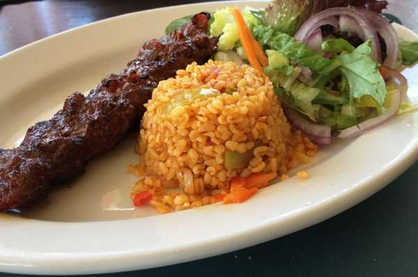 Adana kebab with bulgur wheat and salad is