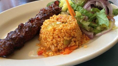 Adana kebab with bulgur wheat and salad is