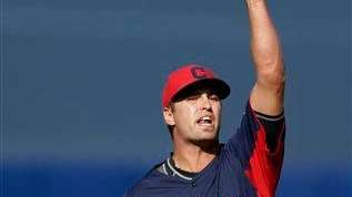 Cleveland Indians starting pitcher David Huff points to