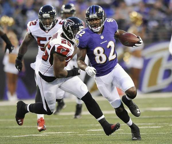 Baltimore Ravens wide receiver Torrey Smith carries the