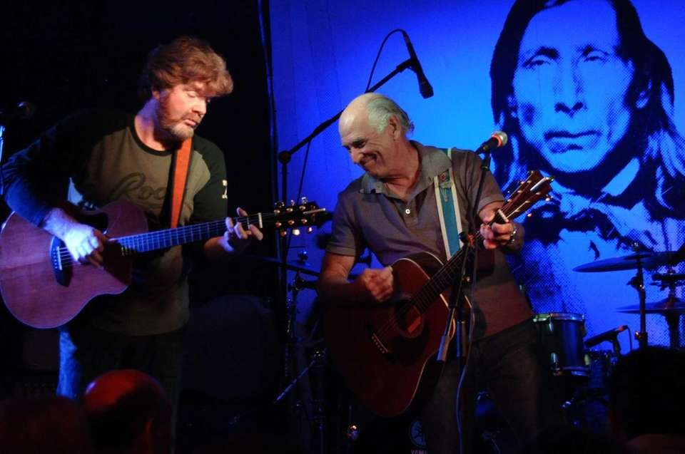 Jimmy Buffett, right, plays with Mac McAnally at