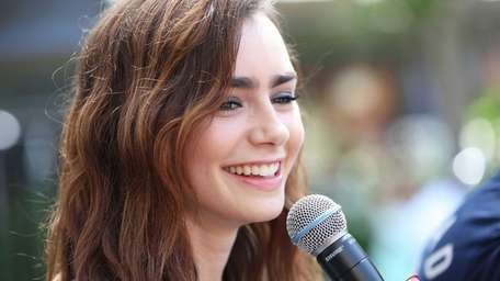 Lily Collins attends the