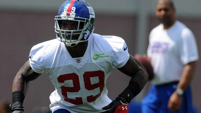 Giants running back Michael Cox works on blocking