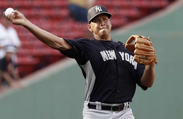 Yankees third baseman Alex Rodriguez throws before a