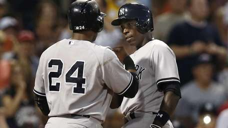 Yankees' Alfonso Soriano is greeted at home by