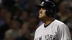 Yankees' Alex Rodriguez grimaces after fouling off a