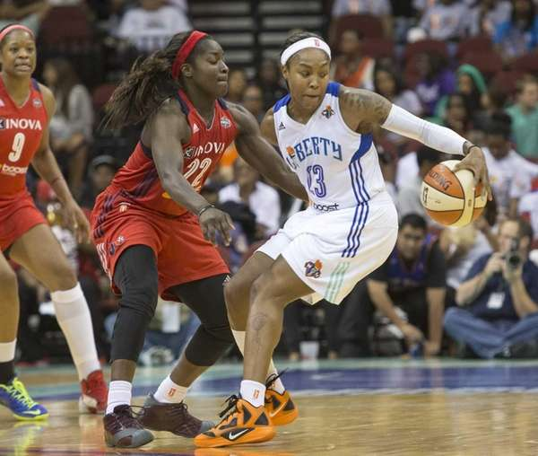 Liberty's Cappie Pondexter spins away from the Mystics'