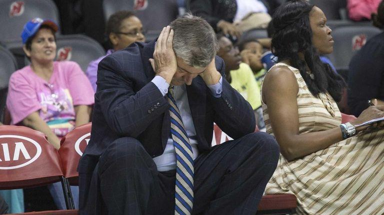 Liberty head coach Bill Laimbeer hangs his head