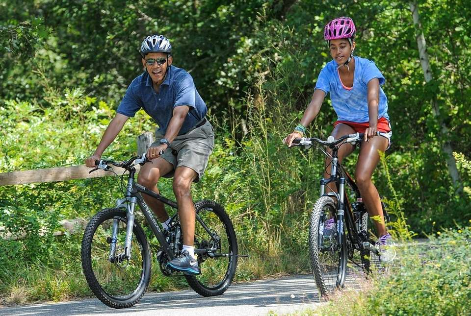 President Barack Obama and his daughter, Malia, ride