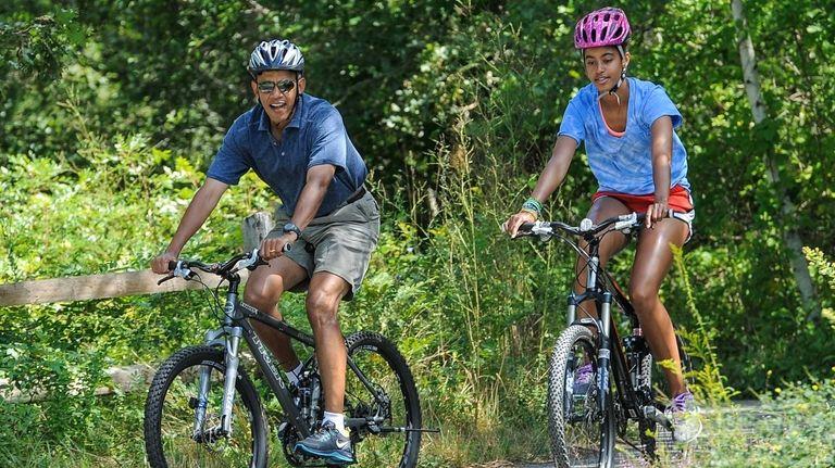 President Barack Obama and his daughter, Malia, ride