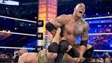 WWE Champion The Rock attempts to make John