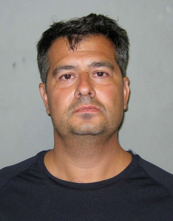 Simon C. Dolmaian was arrested on the New