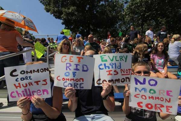 People rally against the current Common Core state