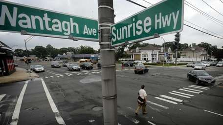 Pedestrians cross Sunrise highway at Wantagh Avenue in