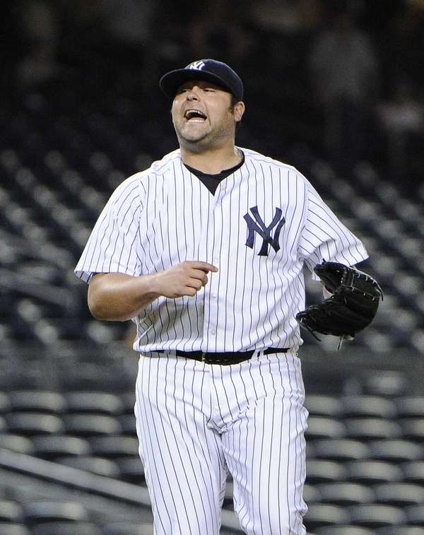 Yankees pitcher Joba Chamberlain reacts at the end