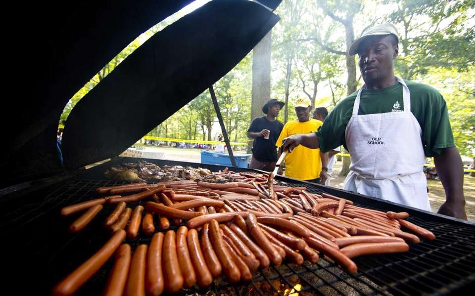 Clifford Beverly, of Amityville, cooks hot dogs at