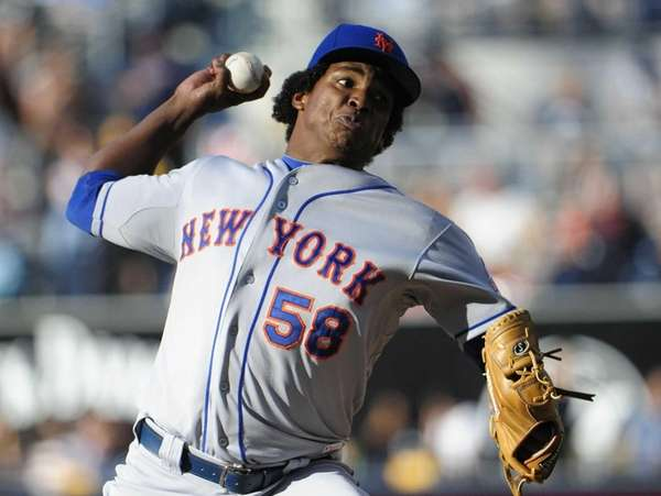 Jenrry Mejia pitches during the first inning against