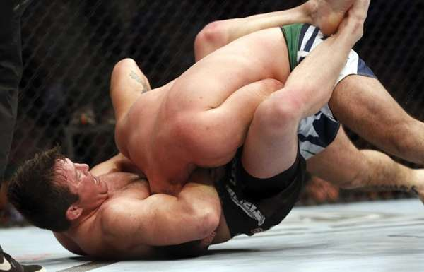 Chael Sonnen, left, sinks in the fight-winning choke