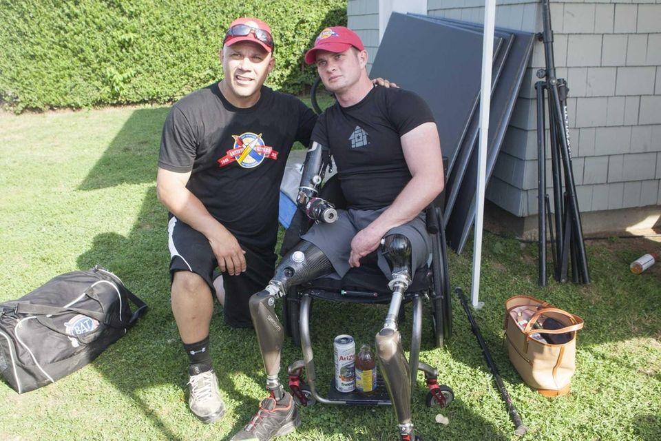 Former Yankee Jim Leyritz, left, poses with Marine