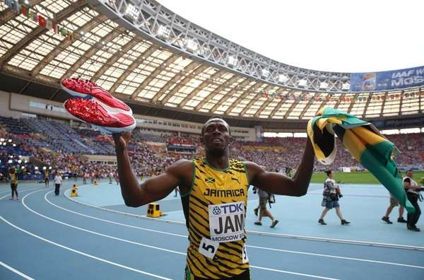Jamaica's Usain Bolt celebrates after winning the men's