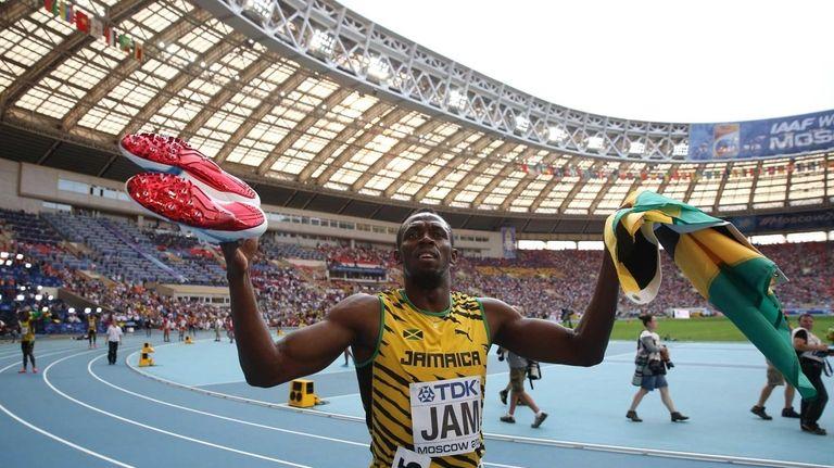 Jamaica's Usain Bolt celebrates after winning the men's