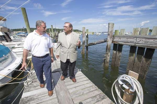 Senior harbormaster Harry Acker, left, and Town of