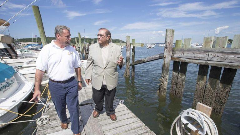 Senior harbormaster Harry Acker, left, and Town of