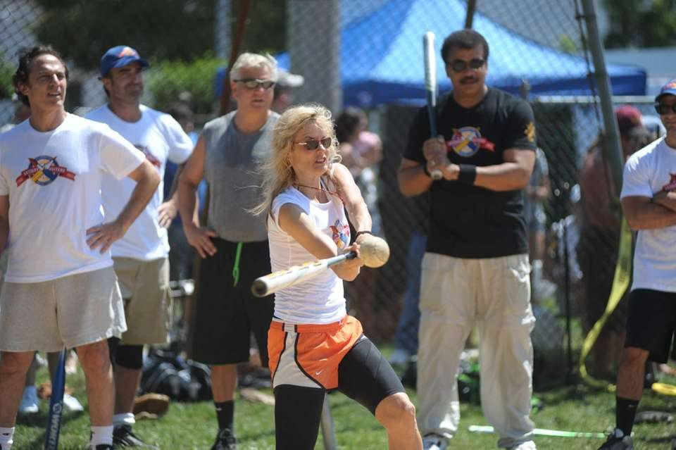 Actress Lori Singer playing ball at the Artists