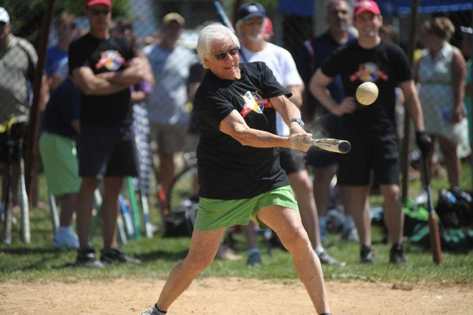 Carl Bernstein takes a swing during the Artists