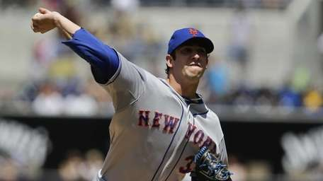 Matt Harvey delivers a pitch during a game