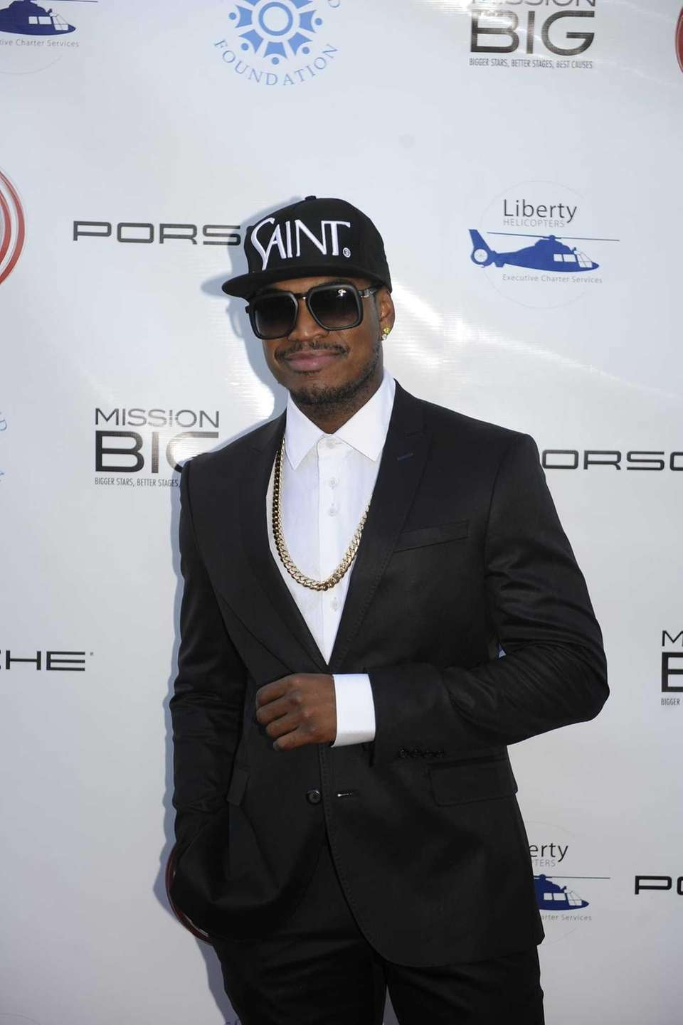 Singer/songwriter Ne-Yo stops for a picture at The