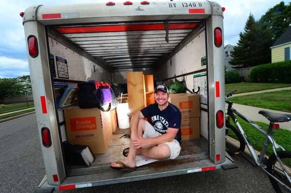 Christopher Lawrence, 32, sits in the U-Haul container