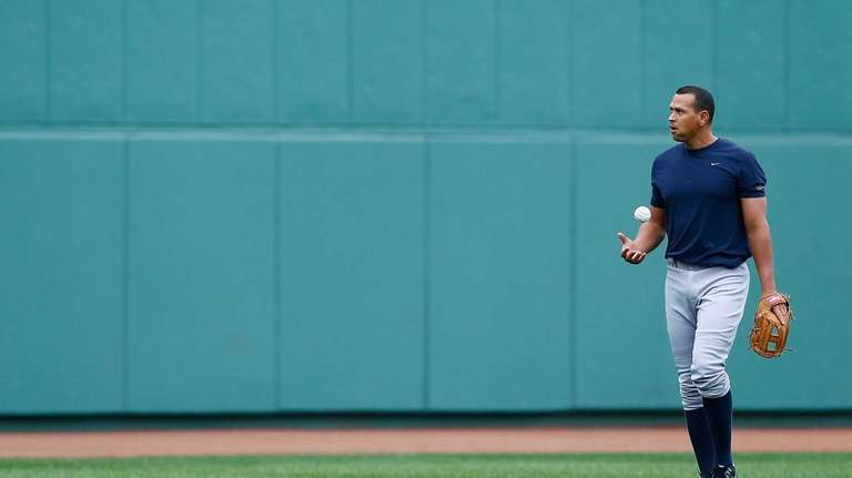 Alex Rodriguez warms up before a game against