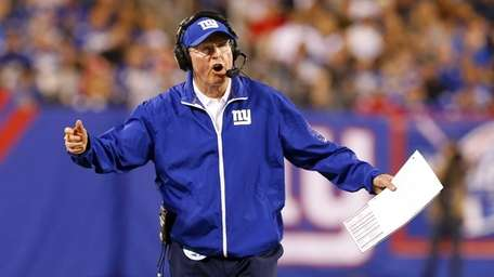 Tom Coughlin shouts during a game against the