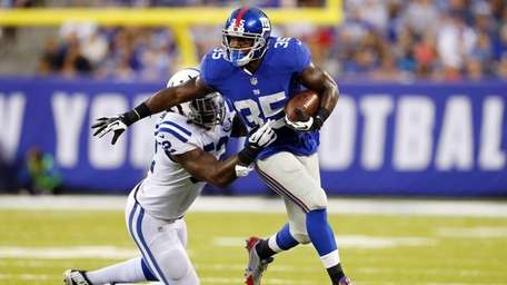 Andre Brown #35 of the Giants runs the