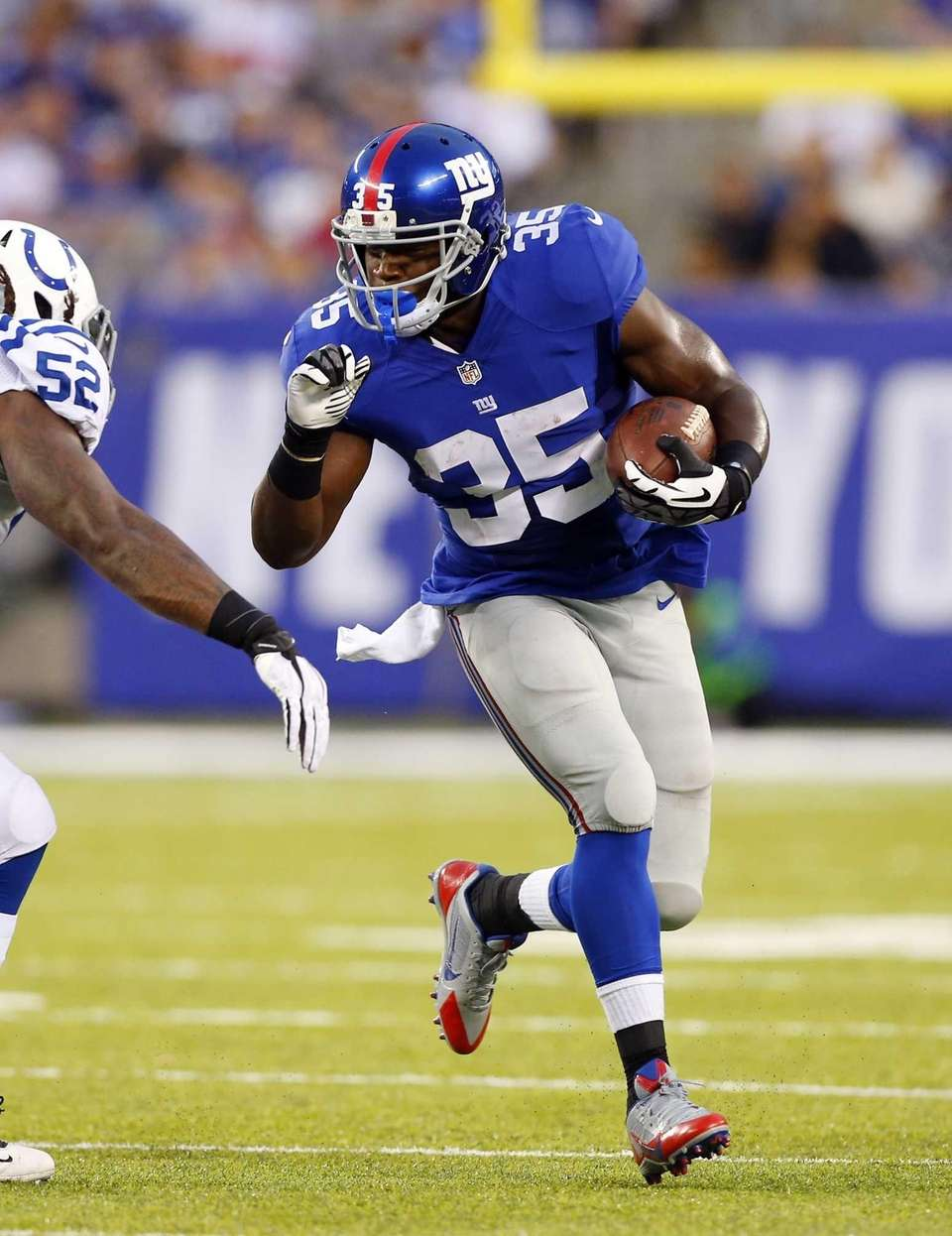 Andre Brown of the Giants runs the ball