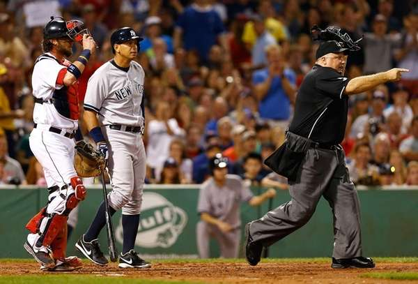 Home plate umpire Brian O'Nora warns both benches