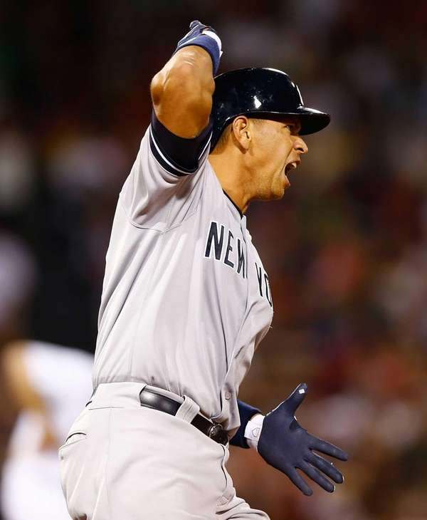 Alex Rodriguez reacts after hitting a solo home