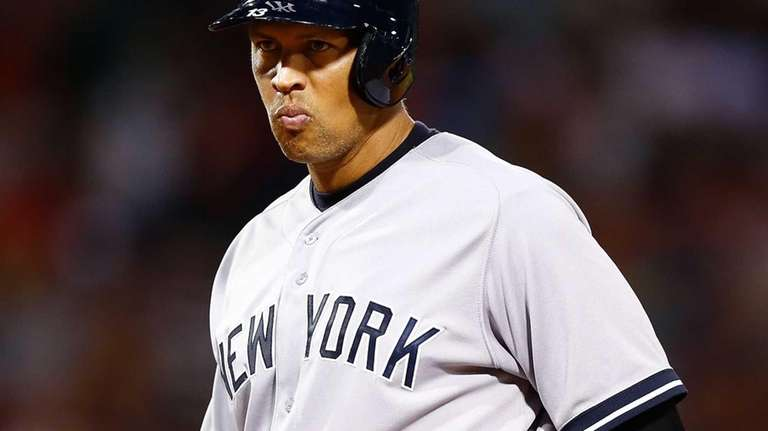 Alex Rodriguez stands at first base following an