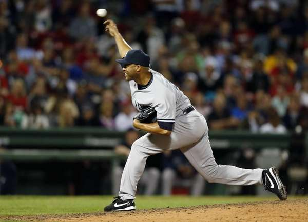 Mariano Rivera delivers a pitch in the ninth