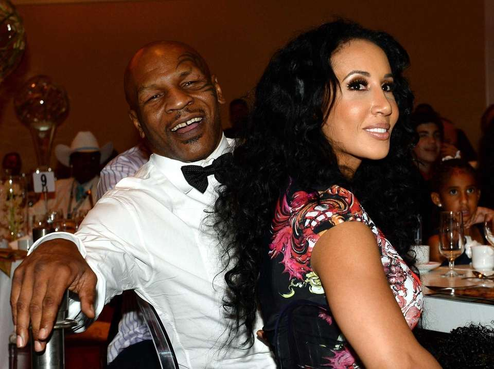 Former boxer and inductee Mike Tyson, left, and