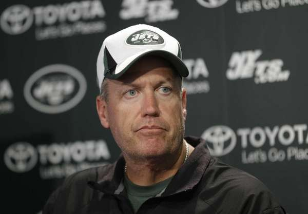 Rex Ryan talks to reporters after a practice