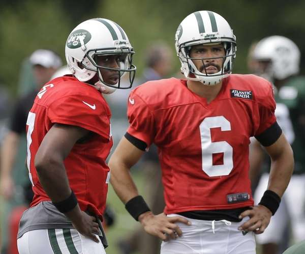 Geno Smith, left, and Mark Sanchez participate in