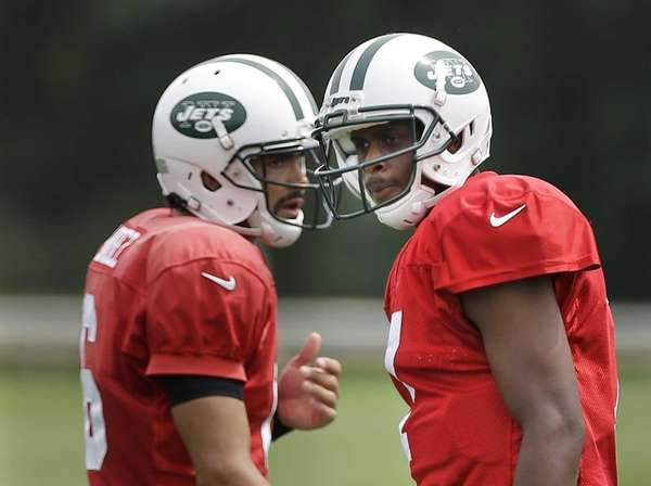 Geno Smith and Mark Sanchez participate in a