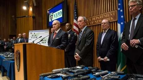 Ray Kelly, left, Bloomberg announce largest gun bust